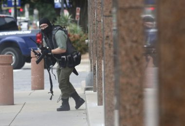 22 year old veteran Brian Issack Clyde Carrying Rifle at Dallas Federal Courthouse